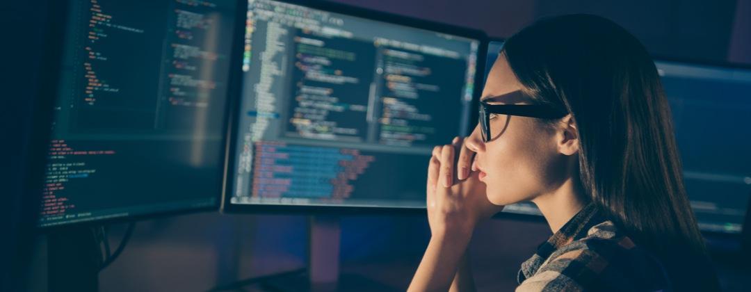 programmer checks her code.