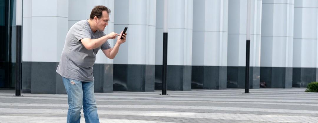 A man tries to catch Pokémon while playing Pokémon GO.