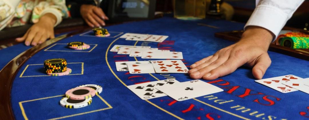 A live game of blackjack in progress at a blackjack table.